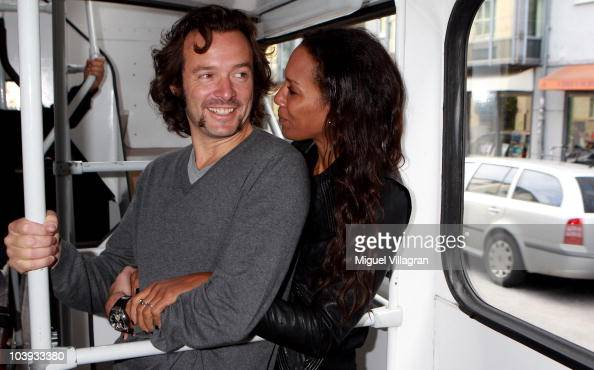 Belgian artist Arne Quinze and his wife Barbara Becker ride a bus on the way to create art installations at random places on September 9 2010 in...