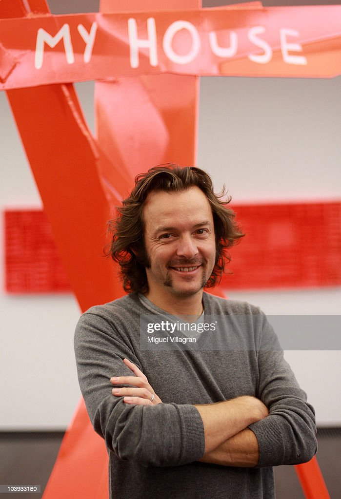 Belgian artist <a gi-track='captionPersonalityLinkClicked' href=/galleries/search?phrase=Arne+Quinze&family=editorial&specificpeople=5087007 ng-click='$event.stopPropagation()'>Arne Quinze</a> poses in front of his art at the Thomas Modern gallery on September 9, 2010 in Munich, Germany. Quinze's show 'My Home, My House, My Stilthouse' opens on September 10, 2010.