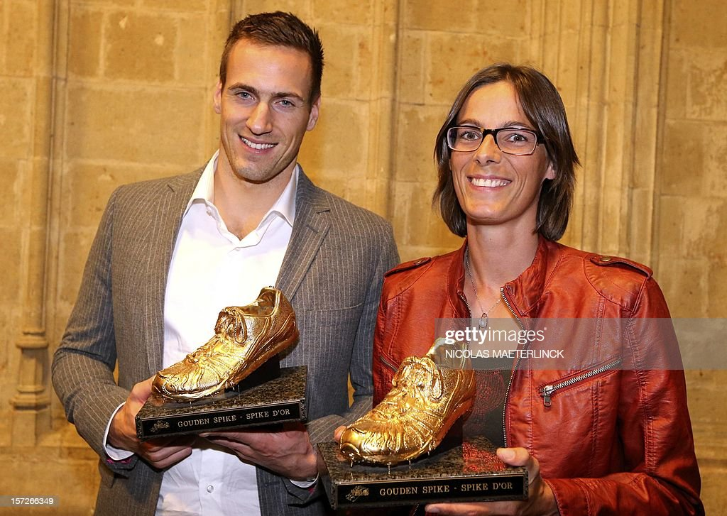 Belgian athletes Hans Van Alphen and Tia Hellebaut pose with their trophies after winning at the ceremony for the Golden Spikes athletics awards for best Belgian athlete, on December 1, 2012 in Ghent. MAETERLINCK