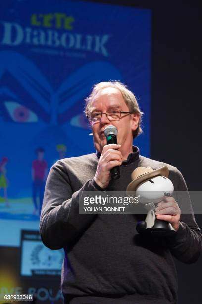 Belgian cartoonist Thierry Smolderen speaks after receiving the SNCF detective novel prize for his comic book 'L'Ete Diabolik' on January 28 during...