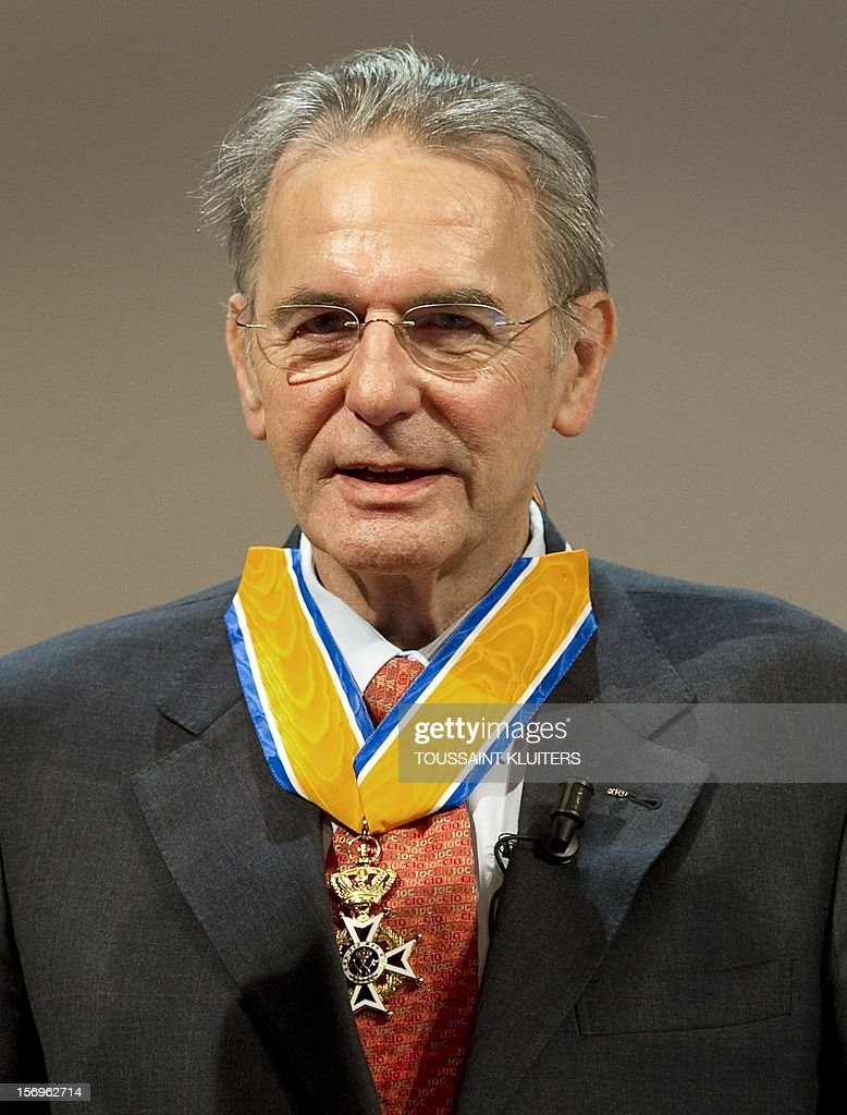 Belgian Chairman of the International Olympic Committee (IOC) Jacques Rogge speaks on November 26, 2012 after being awarded commander in the Order of Orange-Nassau by the Dutch sports minister during an IOC World Congress on sport, culture and education in Amsterdam. The Order of Orange-Nassau is a military and civil Dutch cavalry order open to 'everyone who has earned special merits for society.' KLUITERS - netherlands out -