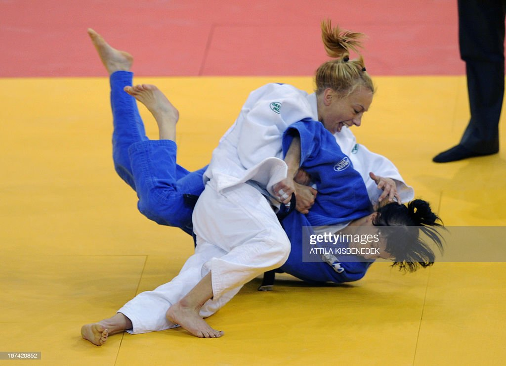 Belgian Charline van Snick (white) figths with her Russian opponent, Kristina Rumyantseva (blue) during Judo European Championships in the women 48 kg category, on April 25, 2013 in Budapest.