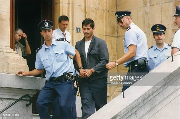 Belgian child rapist Marc Dutroux leaves the court of justice of Neufchateau