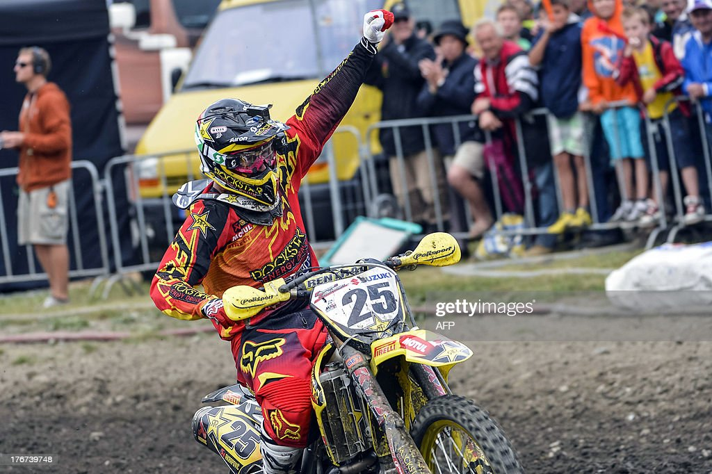 Belgian Clement Desalle celebrates on his bike after winning the motocross MX1 Belgian Grand Prix, on August 18, 2013 in Bastogne.