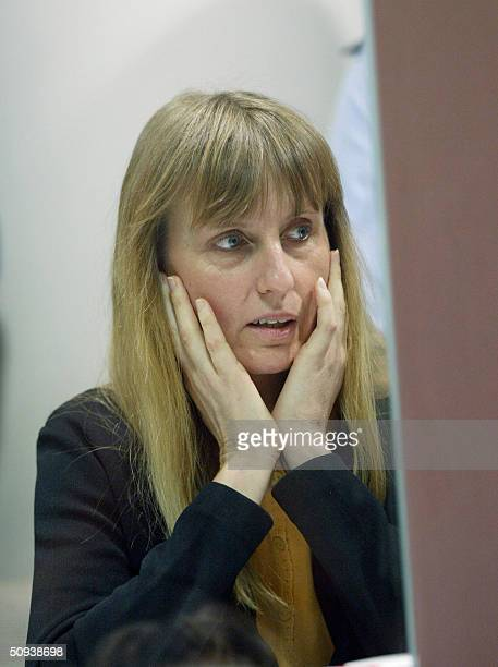 Belgian convicted paedophile Marc Dutroux' estranged wife Michelle Martin reacts during the 08 June 2004 session of Dutroux and his accomplices trial...