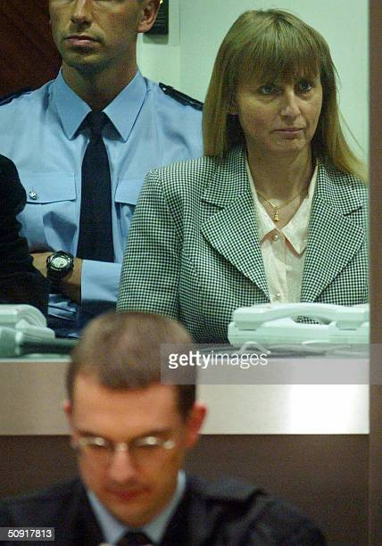 Belgian convicted pedophile Marc Dutroux's estranged wife Michelle Martin sits in the dock as one of her lawyers Thierry Bayet is reads a document...