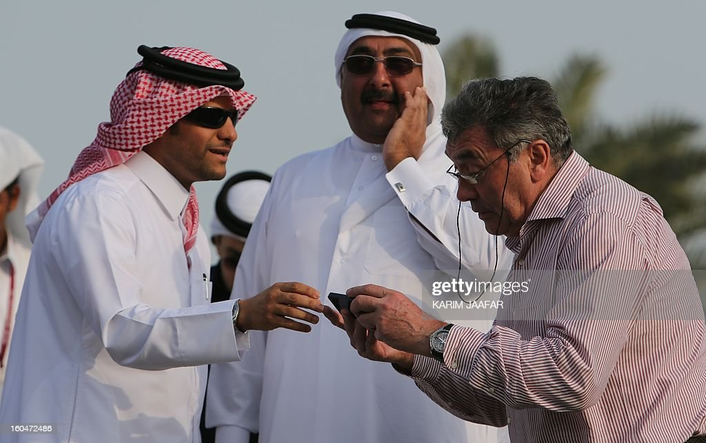 Belgian cycling legend Eddy Merckx (R) chats with president of the Qatar Cycling Federation, Sheikh Khaled bin Ali al-Thani (C) and Sheikh Saud bin Abdul Rahman al-Thani, Secretary General of Qatar's Olympic Committee, during the final stage of the Tour of Qatar women's cycling race in the capital Doha, on February 1, 2013. The route of the final and fourth stage covered 86.5 kilometres from the Sealine Beach Resort to the Doha Corniche.
