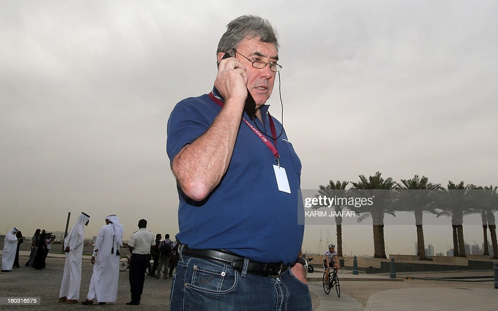 Belgian cycling legend Eddy Merckx talks on his mobile as he attends the first stage of the Tour of Qatar women's cycling race in the capital Doha, on January 29, 2013. The route of the first stage covers 97 kilometres from the Qatar Islamic Art Museum to the southern city of Mesaieed.
