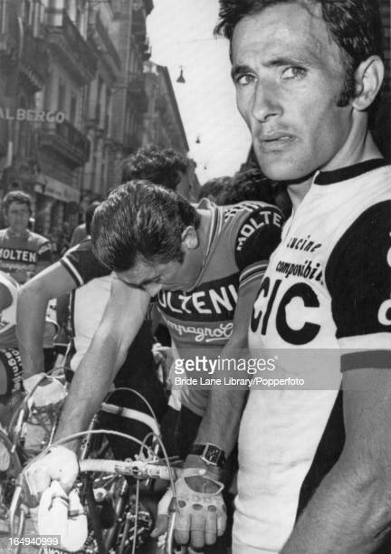 Belgian cyclist Eddy Merckx and Spanish cyclist Miguel Maria Lasa crying as they arrive in Catania Sicily during the Tour of Italy and hear news of...
