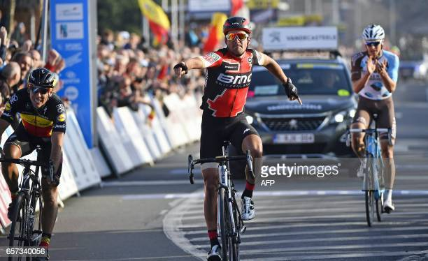 Belgian cyclist Greg Van Avermaet of BMC Racing Team celebrates as he crosses the finish line to win the 60th edition of the E3 Harelbeke cycling...