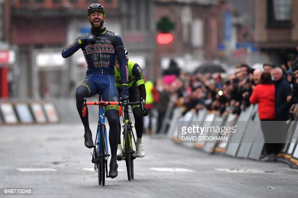 Belgian cyclist Guillaume Van Keirsbulck of WantyGroupe Gobert celebrates after crossing the finish line to win the 49th edition of the Grand Prix du...