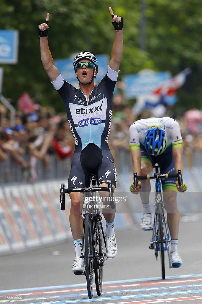 Belgian cyclist Iljo Keisse celebrates as he crosses the finish line to win the 21st and final stage of the 98th Giro d'Italia Tour of Italy cycling...