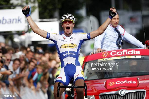 Belgian cyclist Jelle Wallays celebrates as he passes the finish line in Rotterdam on August 30 and wins the first stage from Antwerp to Rotterdam of...