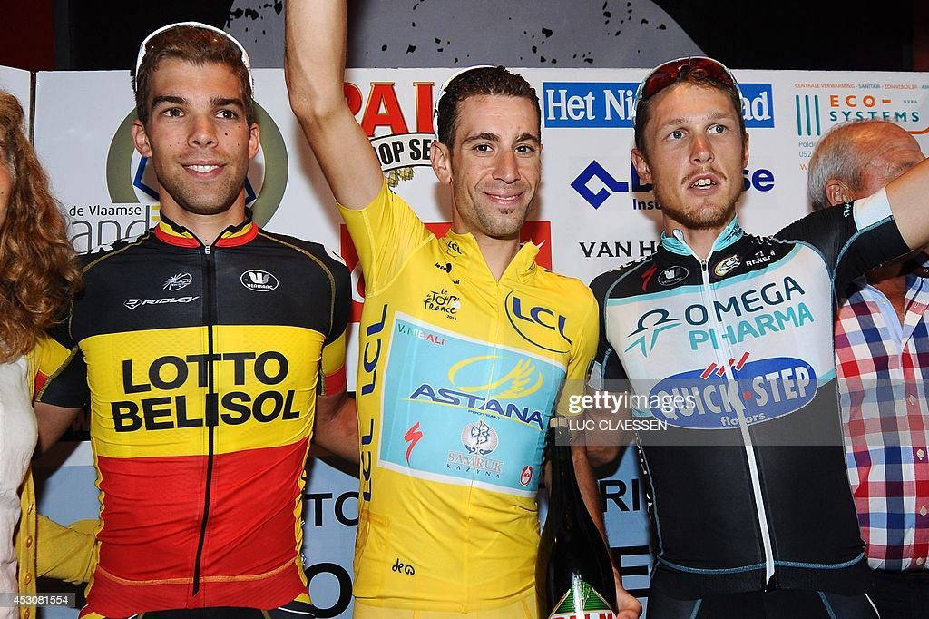 Belgian cyclist Jens Debusschere of Lotto-Belisol, Italian cyclist Vincenzo Nibali of Astana Pro Team, and Italian cyclist Matteo Trentin of team Omega Pharma-Quick Step celebrate on the podium after finishing the 10th edition of the 'Natourcriterium' cycling race on August 2, 2014 in Wolvertem. The contest is a part of the traditional 'criteriums', local races in which mainly cyclists who rode the Tour de France compete. AFP PHOTO / BELGA / LUC CLAESSEN **Belgium out**