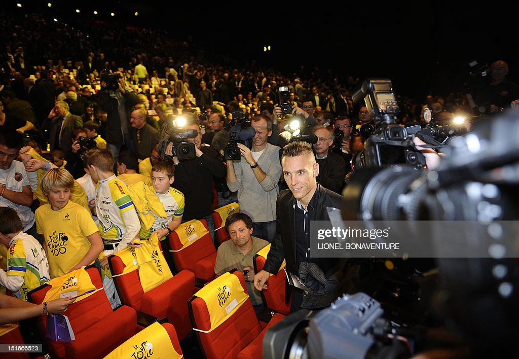 Belgian cyclist Philippe Gilbert arrives to attend the unveiling of the 2013 cycling classic Tour de France route during a press conference on October 24, 2012 in Paris. The 100th edition of the Tour will take place from June 29 to July 21 and will start in Corsica for the first time in it's history.