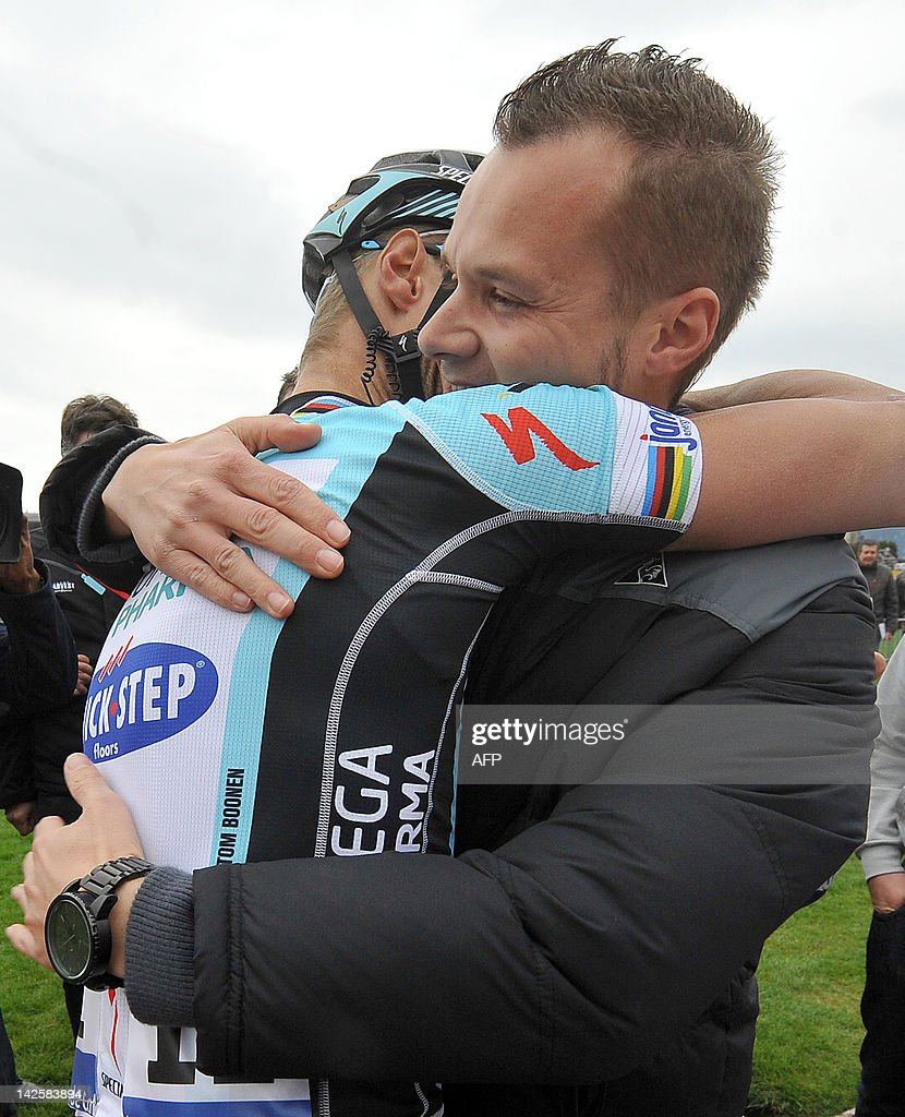 Belgian cyclist Tom Boonen of team Omega Pharma-Quick Step is congatulated by his brother Sven at the end of the 110th edition of the Paris-Roubaix one-day classic cycling race, on April 8, 2012, in Roubaix, northern France. Boonen, who had previously won in 2005, 2008 and 2009, equals the record of wins in Paris-Roubaix held by compatriot Roger De Vlaeminck. Boonen won the race ahead of French Sebastien Turgot (Team Europcar) and Italian Alessandro Ballan (Team BMC).