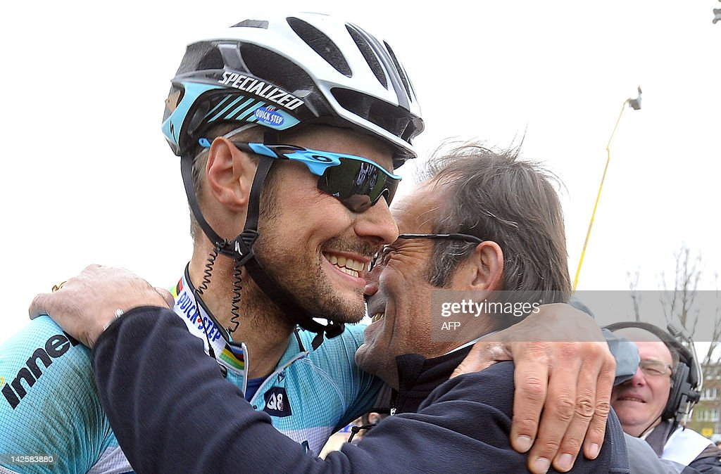 Belgian cyclist Tom Boonen of team Omega Pharma-Quick Step is congatulated by former cyclist Gilbert Duclos-Lassalle at the end of the 110th edition of the Paris-Roubaix one-day classic cycling race, on April 8, 2012, in Roubaix, northern France. Boonen, who had previously won in 2005, 2008 and 2009, equals the record of wins in Paris-Roubaix held by compatriot Roger De Vlaeminck. Boonen won the race ahead of French Sebastien Turgot (Team Europcar) and Italian Alessandro Ballan (Team BMC).