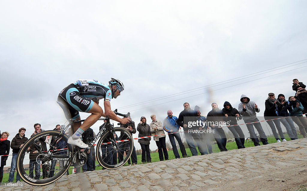 Belgian cyclist Tom Boonen of team Omega Pharma-Quick Step takes a curve on a cobblestoned road during the 110th edition of the Paris-Roubaix one-day classic cycling race on April 8, 2012, in Roubaix, northern France. Boonen, who had previously won in 2005, 2008 and 2009, equals the record of wins in Paris-Roubaix held by compatriot Roger De Vlaeminck. Boonen won the race ahead of French Sebatsien Turgot (Team Europcar) and Italy's Alessandro Ballan (Team BMC).