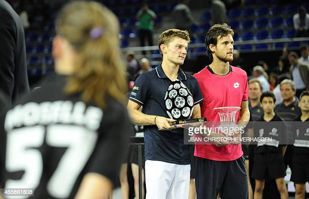 Belgian David Goffin holds the trophy after defeating his Portuguese opponent Joao Sousa during their ATP Moselle Open final tennis match on...