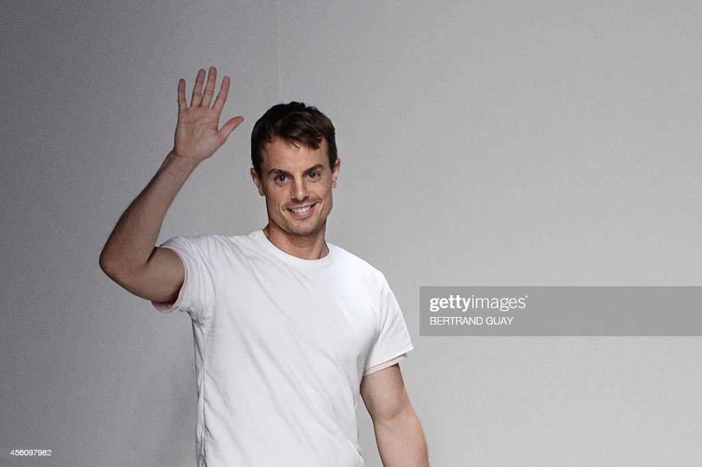 Belgian designer Christian Wijnants acknowledges the audience at the end of his 2015 Spring/Summer readytowear collection fashion show on September...