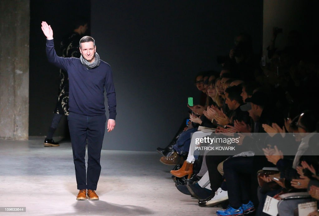 Belgian designer Dries Van Noten acknowledges the audience during the men's Fall-Winter 2013-2014 collection show on January 17, 2013, during the Men's fashion week in Paris. AFP PHOTO / PATRICK KOVARIK