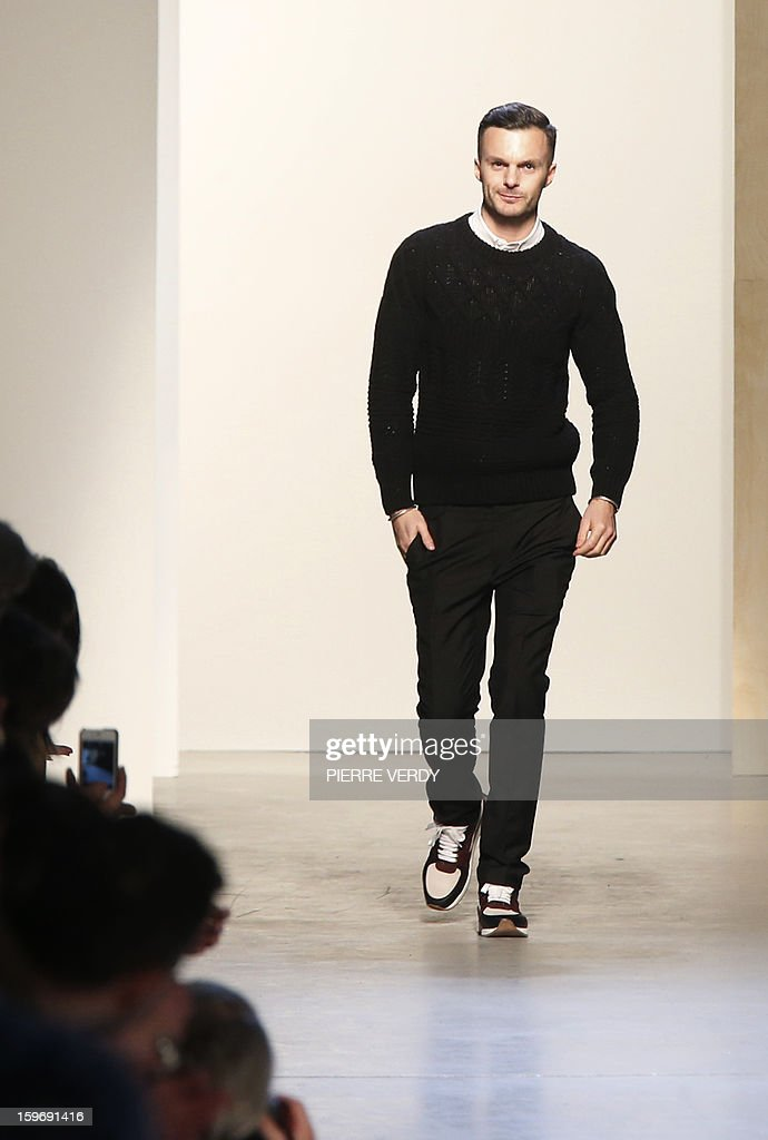 Belgian designer Kris Van Assche acknowledges the audience at the end of his Fall-Winter 2013-2014 collection show on January 18, 2013 during the men's fashion week in Paris.