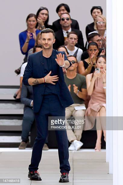 Belgian designer Kris Van Assche for the label Dior acknowledges the audience at the end of the men's springsummer 2013 fashion collection show on...