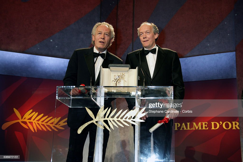 Belgian directors Jean-Pierre and Luc Dardenne make a speech after receiving the coveted 'Palme d'Or' at the closing ceremony of the 58th Cannes Film Festival.