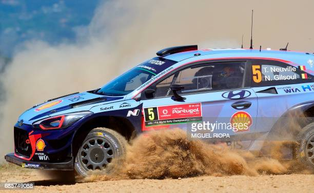 Belgian driver and codriver Thierry Neuville and Nicolas Gilsoul steer their Hyundai i20 Coupe WRC in Amarante northern Portugal on May 20 during the...