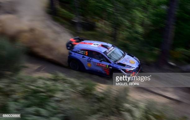 Belgian driver Thierry Neuville and codriver also Belgian Nicolas Gilsoul steer their Hyundai i20 Coupe WRC in Amarante northern Portugal on May 20...