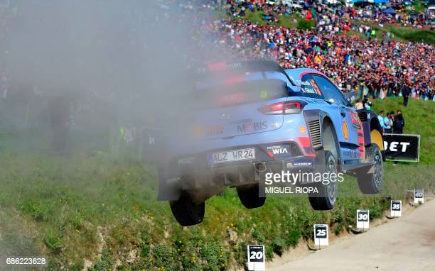 Belgian driver Thierry Neuville and codriver also Belgian Nicolas Gilsoul steer their Hyundai i20 Coupe WRC in Fafe northern Portugal on May 21...