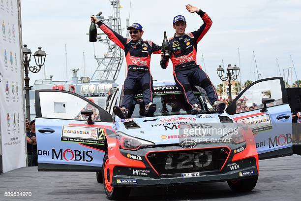 Belgian driver Thierry Neuville and codriver Nicolas Gilsoul celebrate as they won on the podium of the 2016 FIA World Rally Championship in Sardegna...
