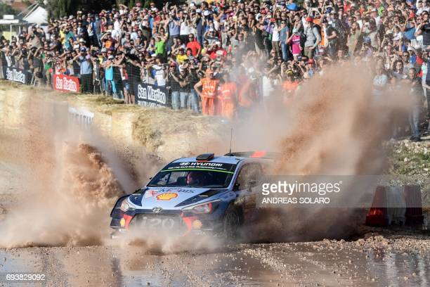 TOPSHOT Belgian driver Thierry Neuville and codriver Nicolas Gilsoul drive their Hyundai i20 Coupe WRC at 'Arena motocross' near Ittiri on June 8...
