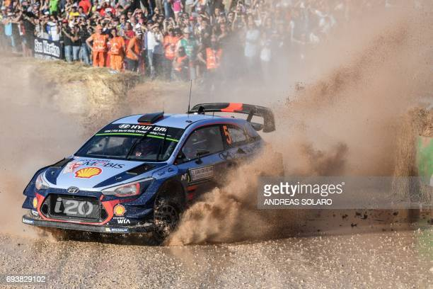 Belgian driver Thierry Neuville and codriver Nicolas Gilsoul drive their Hyundai i20 Coupe WRC at 'Arena motocross' near Ittiri on June 8 during the...