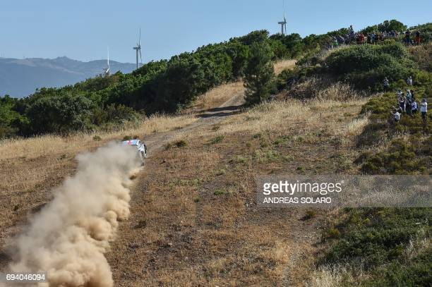 Belgian driver Thierry Neuville and compatriot codriver Nicolas Gilsoul race their Hyundai i20 Coupe WRC near Tula village on the second day of the...