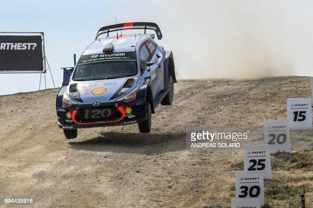 Belgian driver Thierry Neuville and compatriot codriver Nicolas Gilsoul race their Hyundai i20 Coupe WRC during the Micky's Jumps at Monte Lerno on...