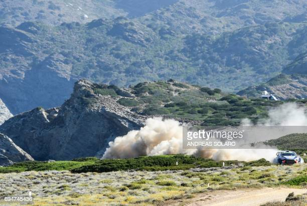 Belgian driver Thierry Neuville and compatriot codriver Nicolas Gilsoul race their Hyundai i20 Coupe WRC during the race at Argentiera near Alghero...