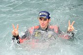 TOPSHOT Belgian driver Thierry Neuville celebrates the victory in the water of the 2016 FIA World Rally Championship in Sardegna on June 12 2016 /...