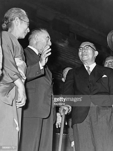 Belgian economist Camille Gutt President of the International Chamber of Commerce chats with Japanese Prime Minister Ichiro Hatoyama during a gala...