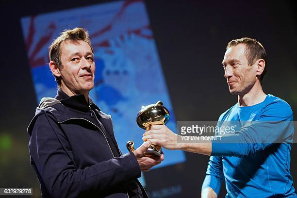 Belgian Eric Lambe and Philippe de Pierpont react after receiving the 'Fauve d'Or' trophy the award for the best comic book for their comic book...