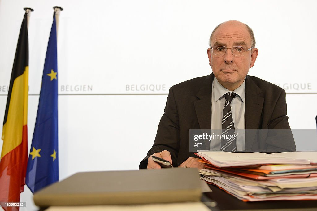 Belgian Finance minister Koen Geens gives a press conference to announce an agreement on the budget after a inner cabinet meeting on October 8, 2013 in Brussels.
