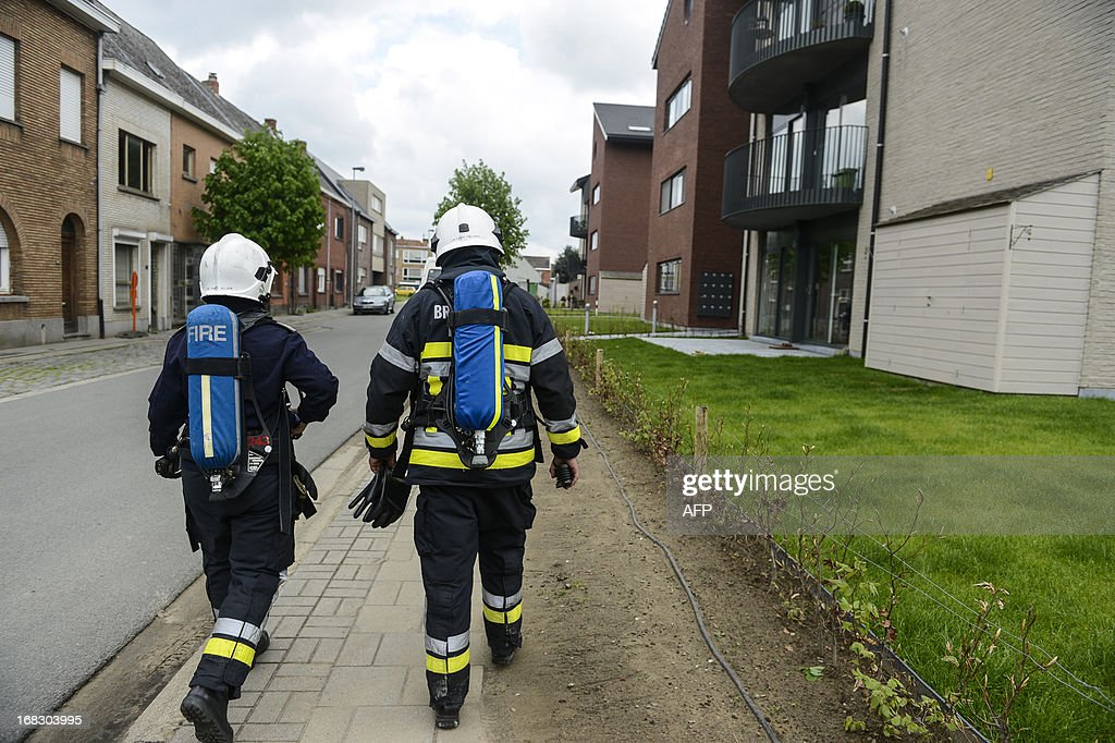 Belgian firefighters head to measure cyanide rate in a street in Wetteren on May 8, 2013. In the night of May 4 to 5 a freight train derailed and exploded on a track near Schellebelle, part of Wichelen, Wetteren. The train contained the chemical product acrylonitrile, a toxic and inflammable fluid that can cause breathing problems. Emergency services evacuated some 500 residents. One local resident died and 49 persons were brought to hospital. Belgium Out