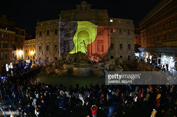 Belgian flag is display on the Trevi Fountain in Rome on March 22 2016 in tribute to the victims of Brussels following triple bomb attacks in the...