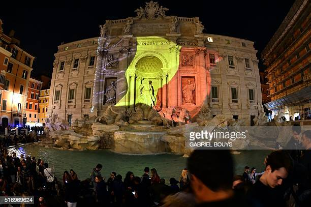 A Belgian flag is display on the Trevi Fountain in Rome on March 22 2016 in tribute to the victims of Brussels following triple bomb attacks in the...