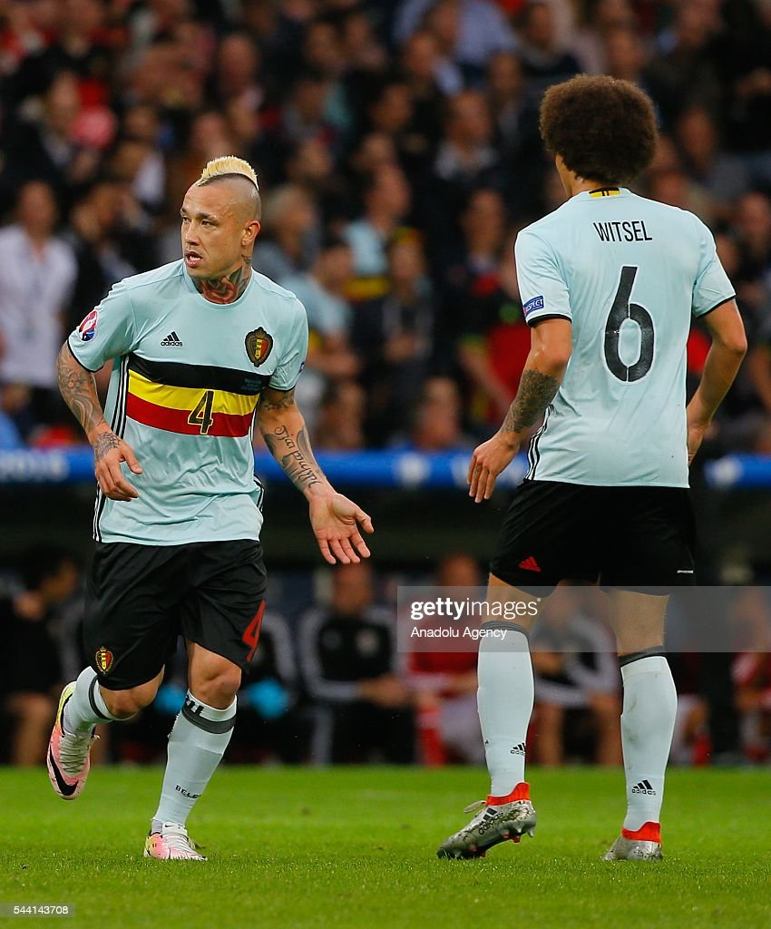 Belgian football players celebrate after scoring a goal during the Euro 2016 quarter-final football match between Wales and Belgium at the Stadium Pierre Mauroy in Lille, France on July 1, 2016.