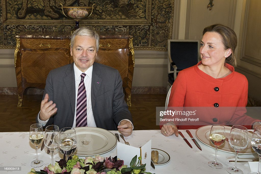 Belgian Foreign Minister and Vice Prime Minister Didier Reynders (L) and Princess Claire of Belgium prepare to share a meal with guests after French journalist and author Stephane Bern was appointed officer in the King Leopold order during a ceremony at Palais d'Egmont on March 7, 2013 in Brussels, Belgium.