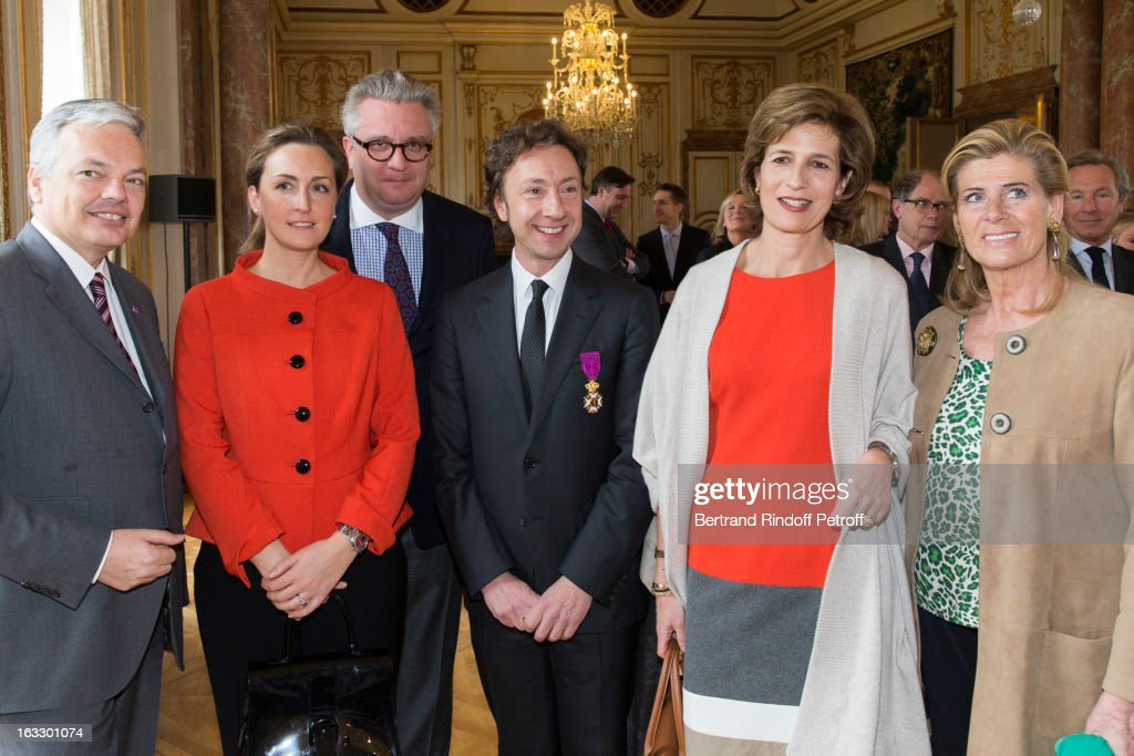 Belgian Foreign Minister and Vice Prime Minister <a gi-track='captionPersonalityLinkClicked' href=/galleries/search?phrase=Didier+Reynders&family=editorial&specificpeople=548982 ng-click='$event.stopPropagation()'>Didier Reynders</a>, Princess Claire of Belgium, Prince Laurent of Belgium, French journalist and author Stephane Bern, Princess Esmeralda of Belgium and Princess Lea of Belgium pose after Bern was appointed officer in the King Leopold order during a ceremony at Palais d'Egmont on March 7, 2013 in Brussels, Belgium.