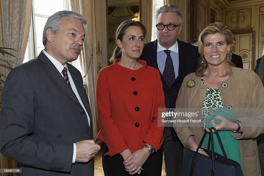 Belgian Foreign Minister and Vice Prime Minister <a gi-track='captionPersonalityLinkClicked' href=/galleries/search?phrase=Didier+Reynders&family=editorial&specificpeople=548982 ng-click='$event.stopPropagation()'>Didier Reynders</a>, <a gi-track='captionPersonalityLinkClicked' href=/galleries/search?phrase=Princess+Claire+of+Belgium&family=editorial&specificpeople=215265 ng-click='$event.stopPropagation()'>Princess Claire of Belgium</a>, <a gi-track='captionPersonalityLinkClicked' href=/galleries/search?phrase=Prince+Laurent+of+Belgium&family=editorial&specificpeople=786930 ng-click='$event.stopPropagation()'>Prince Laurent of Belgium</a> and Princess Lea of Belgium pose prior to French journalist and author Stephane Bern Bern to be appointed officer in the King Leopold order during a ceremony at Palais d'Egmont on March 7, 2013 in Brussels, Belgium.