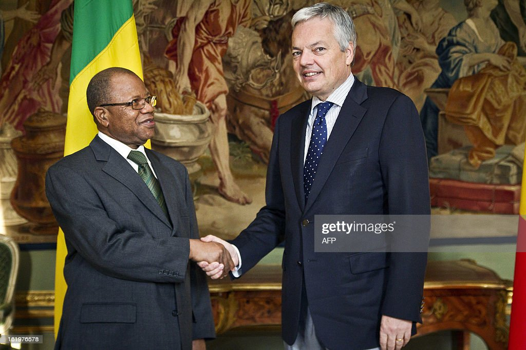 Belgian Foreign Minister and Vice-Prime Minister Didier Reynders (R) shakes ahnds with Malian Prime Minister Diango Sissoko (L) before a meeting at the Egmont Palace in Brussels, on February 18, 2013. Cissoko begins a visit to Brussels for talks on the humanitarian situation in Mali. AFP PHOTO/BELGA /AURORE BELOT -Belgium Out-