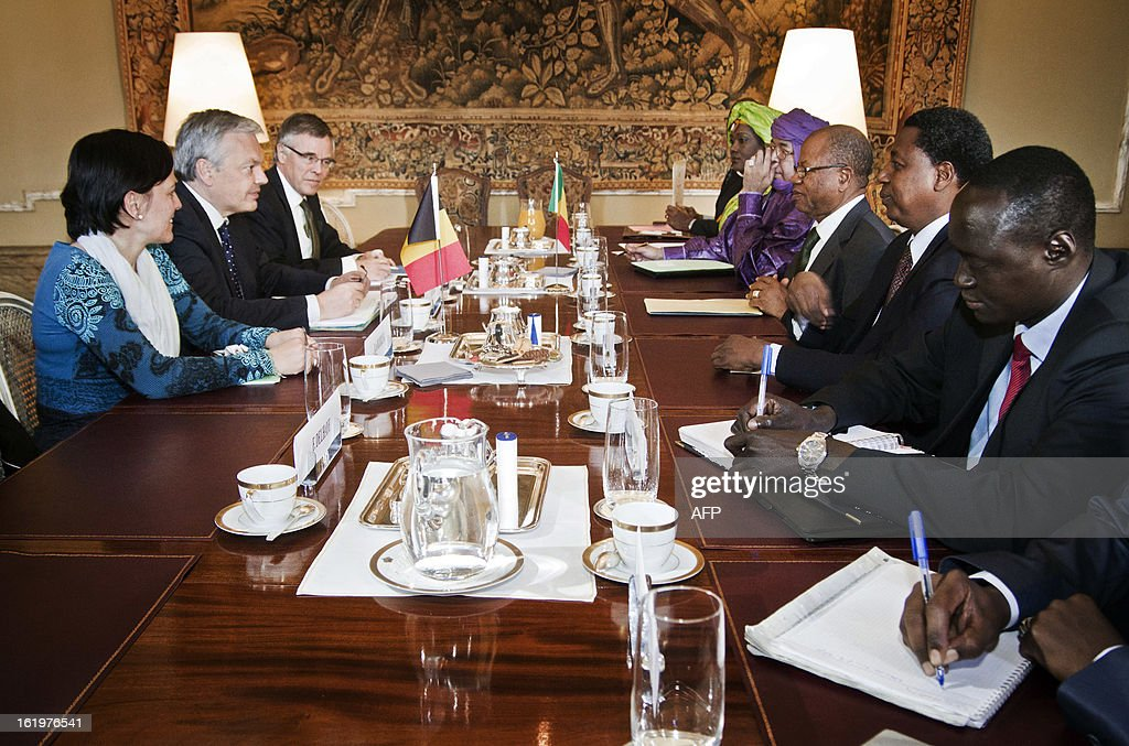 Belgian Foreign Minister Didier Reynders (2L) meets with Malian Prime Minister Diango Sissoko (3R) at the Egmont Palace in Brussels, on February 18, 2013. Cissoko begins a visit to Brussels for talks on the humanitarian situation in Mali. AFP PHOTO/BELGA /AURORE BELOT -Belgium Out-